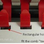 Plastic comb teeth fit the a rectangular hole profile